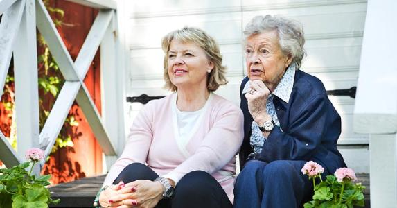 Mother and daughter sitting together on the porch   Maskot/Getty Images